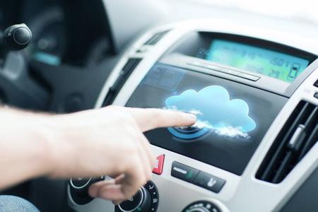 car transmission: transportation, future technology and vehicle concept - man using car control panel Stock Photo