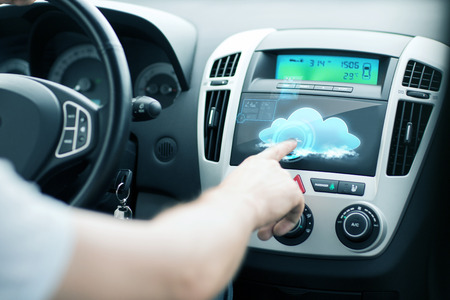 future concept: transportation, future technology and vehicle concept - man using car control panel Stock Photo