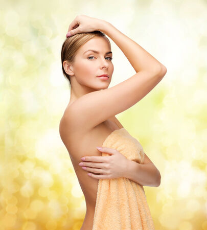woman in shower: health and beauty concept - beautiful woman in towel