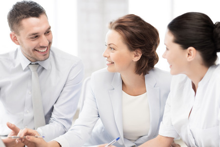 friendly business team having discussion in office photo