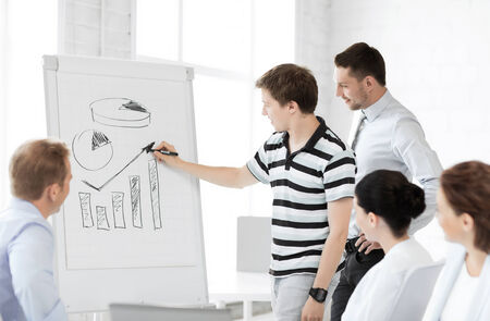 smiling business team working with flipchart in office Stock Photo - 26696654