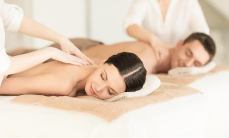 therapeutic massage: picture of couple in spa salon getting massage