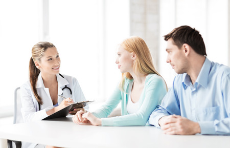 bright picture of doctor with patients in cabinet Stock Photo