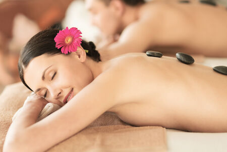 wellness center: picture of couple in spa salon with hot stones