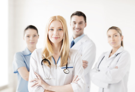 attractive female doctor in front of medical group Stok Fotoğraf
