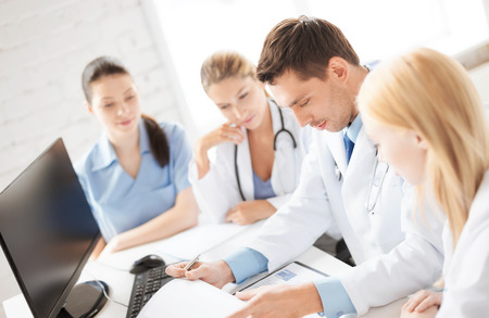 modern doctor: picture of young team or group of doctors working