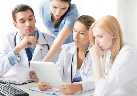 family doctor: picture of young team or group of doctors working