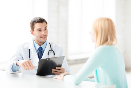 bright picture of male doctor with patient Stock Photo
