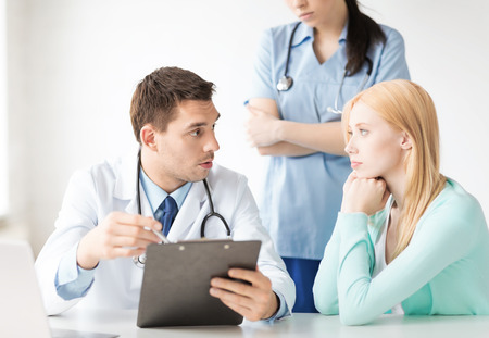 medical cabinet: bright picture of male doctor with patient Stock Photo