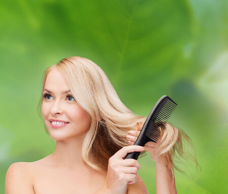 balsam: health and beauty concept - beautiful woman with long hair and brush