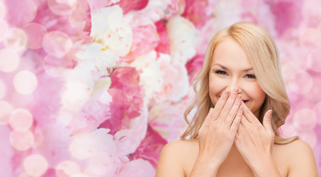 speechless: spa, health and beauty concept - beautiful woman covering her mouth