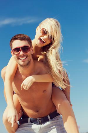 fun in the sun: picture of happy couple having fun on the beach
