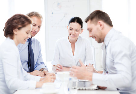 developing: friendly business team having meeting in office Stock Photo