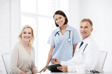 27114436: healthcare and medical concept - doctor and nurse with patient in hospital