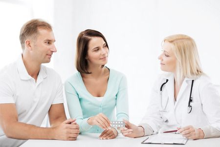 healthcare and medical - doctor giving pills to patients