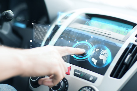 hologram: transportation and vehicle concept - man using car control panel Stock Photo