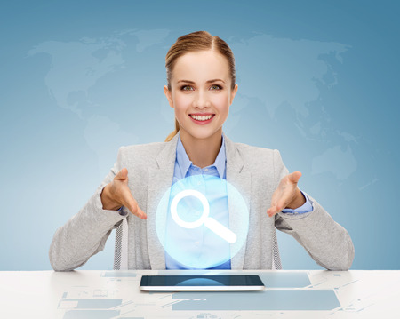 business, technology, internet and office concept - smiling businesswoman with tablet pc computer and magnifying glass icon photo