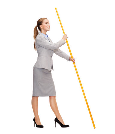 business and advertisement concept - smiling woman holding flagpole with imaginary flag photo