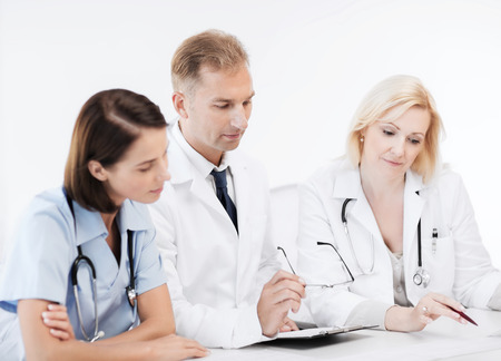healthcare and medical concept - team or group of doctors on meeting photo