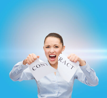 new rules: business, documents, people, legal and real estate concept - serious businesswoman tearing contract Stock Photo
