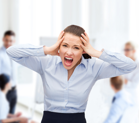overwork: business, office and stress concept - angry screaming businesswoman
