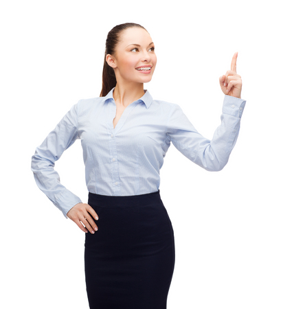 asian teacher: business and education concept - attractive young businesswoman with her finger up looking up Stock Photo