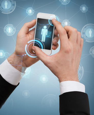 business, internet and technology concept - businessman touching screen of smartphone photo