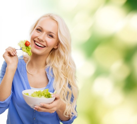 healt, dieting and happiness concept - smiling young woman with green salad Stok Fotoğraf