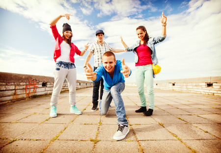 urban dance: sport, dancing and urban culture concept - group of teenagers dancing