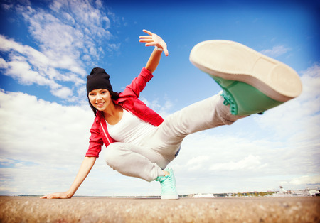 dancing girl: sport, dancing and urban culture concept - beautiful dancing girl in movement