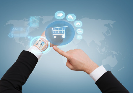 internet shopping, time, business and new technology concept - close up of businessman pointing to virtual watch at his hand photo