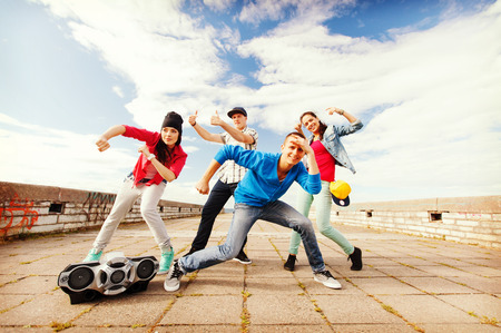 breakdance: sport, dancing and urban culture concept - group of teenagers dancing