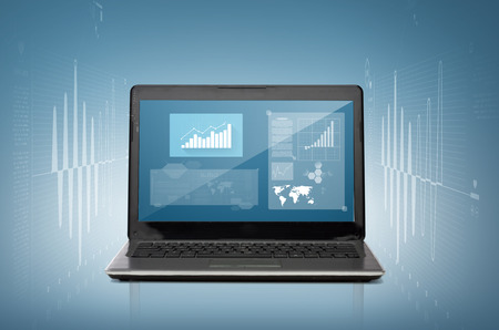 technology and advertisement concept - laptop computer with graph on screen photo