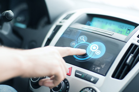 electrical system: transportation and vehicle concept - man using car control panel Stock Photo