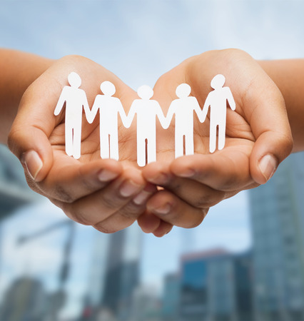 relationships and love concept - womans hands showing paper cutout team photo