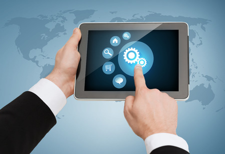 business, internet and technology concept - close up of man hands touching tablet pc photo
