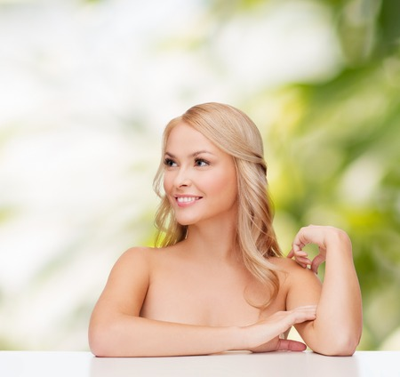 health and beauty concept - face of beautiful woman touching her shoulder skin Stock Photo