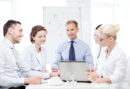 business concept - friendly business team having meeting in office photo