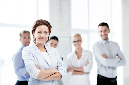 business concept - picture of smiling attractive businesswoman in office photo