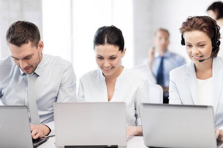 business concept - picture of group of people working with laptops in office photo