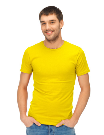 shirt template: clothing design and hapy people concept - handsome man in blank yellow shirt