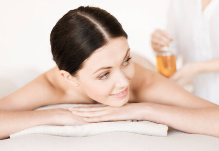 bliss: picture of woman in spa salon getting oil treatment Stock Photo