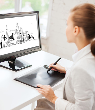 architecture, office, construction and education concept - architect with drawing tablet at office photo