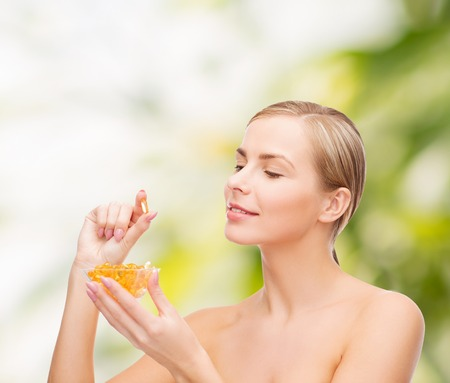 omega 3: healthcare and beauty concept - lovely woman with omega 3 vitamins Stock Photo