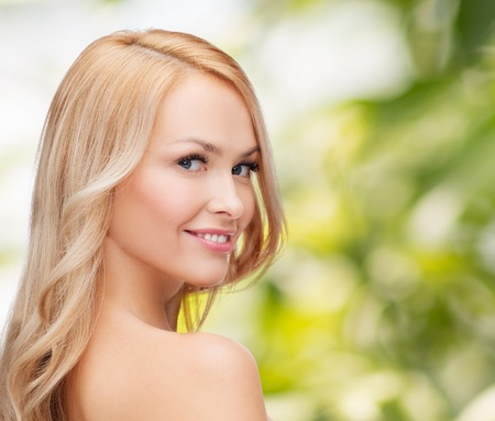 health and beauty concept - face and shoulders of happy woman with long hair photo