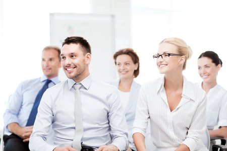 financial executive: business concept - picture of smiling businessmen and businesswomen on conference
