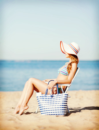 chaise longue: summer holidays and vacation - girl sunbathing on the beach chair Stock Photo