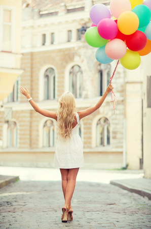 balloon animals: summer holidays, celebration and lifestyle concept - beautiful woman with colorful balloons in the city