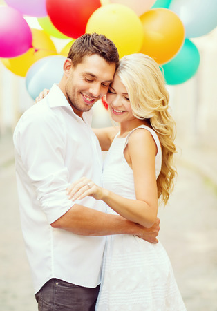 summer holidays, celebration and wedding concept - couple with colorful balloons and engagement ring photo