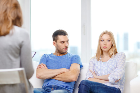 argument from love: love, family, phychology and relationship problems concept - young couple with a problem at psychologist office Stock Photo